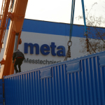 Measuring container in front of meta logo